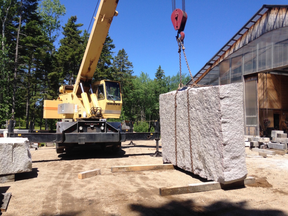 Moving large stone with crane